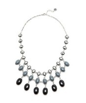 24aacd74deb We ve seen this style of statement necklace in all the brights so what  about a few shades of grey…well