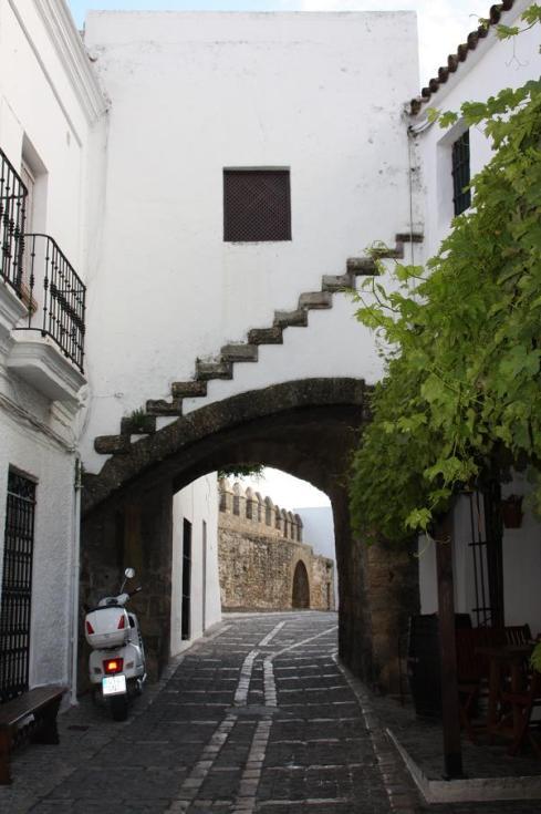 Cobblestone road entering the old gates near the Castle
